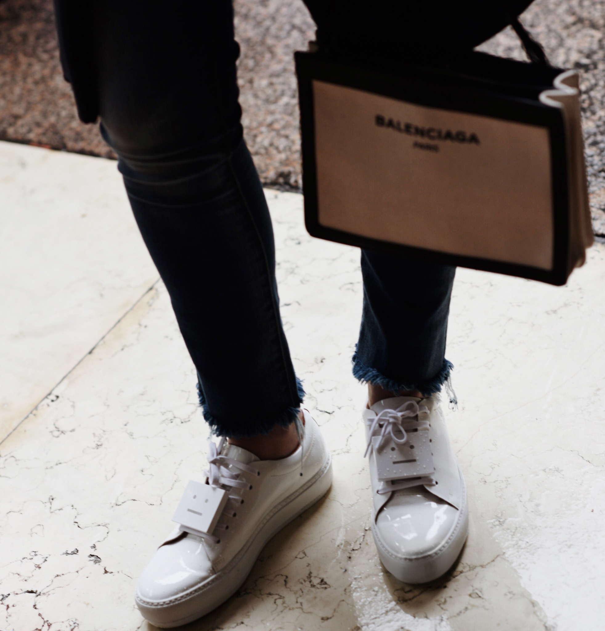 acne-studios-adriana-sneakers-balenciaga-pochette-crossbody-bag-DOUUOD-coat-frayed-hem-jeans-rika-studios-spellonme-personalised-bracelet-ulrika-lundgren-white-shirt-white-sneakers-MFW